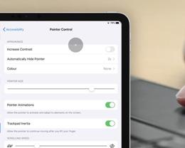 如何在 iPad 上自定义鼠标与触控板的光标跟踪速度?