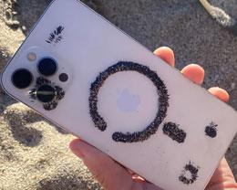 国外用户发现,iPhone 12 背面能够吸引大量铁砂